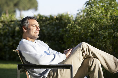 Furniture : Man relaxing in garden