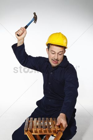 Fixing : Man repairing a stool