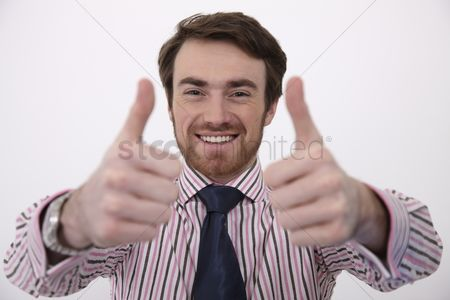 China : Man showing double thumbs up