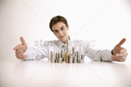Proud : Man showing off stacks of coins