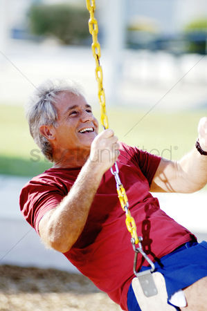 Aging process : Man sitting on a swing