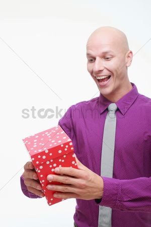Birthday present : Man smiling while looking at his present