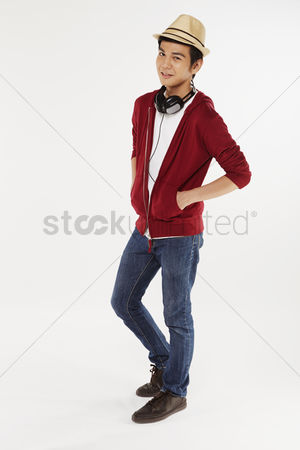 Portability : Man standing with hands in pocket