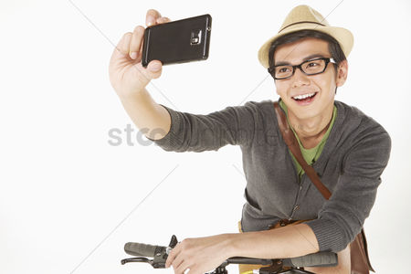 Masculinity : Man taking pictures with mobile phone