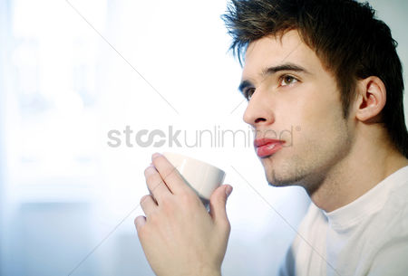 Refreshment : Man thinking while drinking