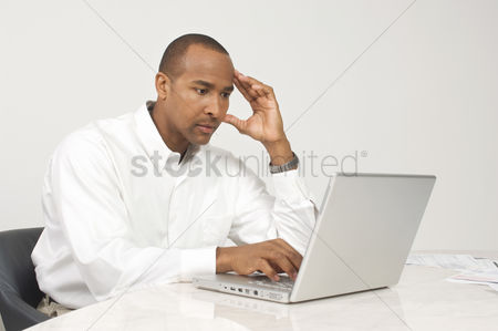Thought : Man using a laptop