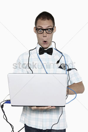 Fixing : Man using laptop  looking surprised
