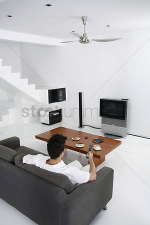 Interior : Man watching television in the living room