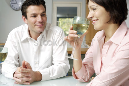 Celebrating : Man watching wife drinking wine