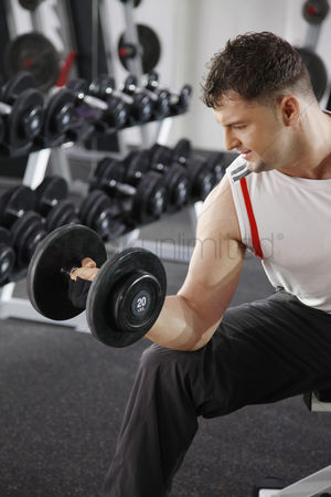 Dumbbell : Man weight lifting in the gym