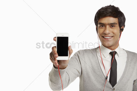 Portability : Man with earphone holding up a mobile phone