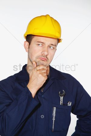 Wondering : Man with hardhat thinking