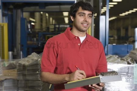Notepad : Man working in newspaper factory