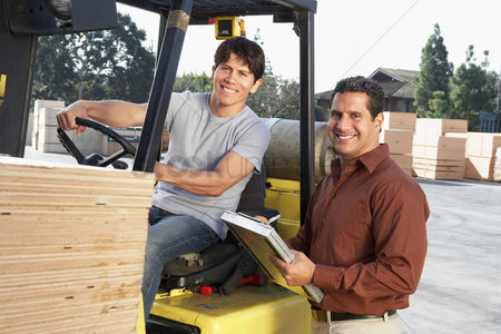 Supervisor : Manager with forklift driver at  warehouse