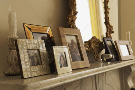 Loss : Marble fireplace mantel with framed pictures and mirror