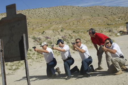Firing : Men firing guns at shooting range