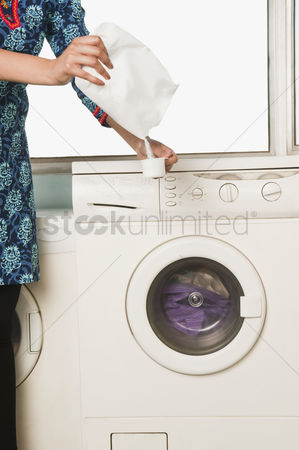 Housewife : Mid section view of a woman doing laundry