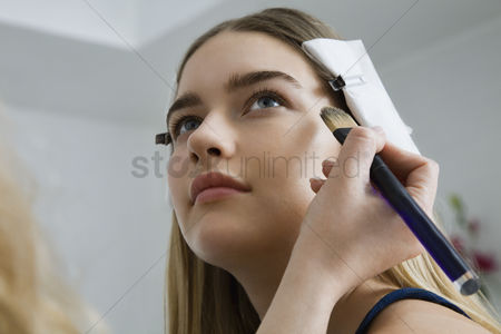 Show : Model having makeup applied
