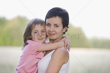 Posed : Mother and daughter in a field
