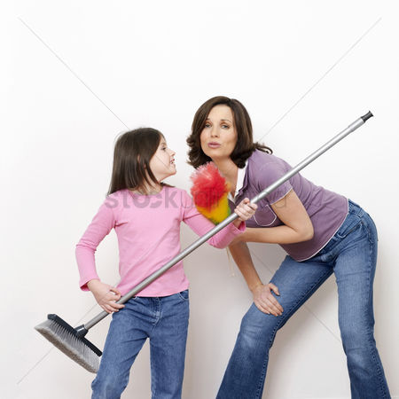 Daughter : Mother and daughter with broom and feather duster