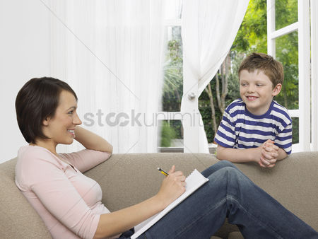Wondering : Mother and young son by couch