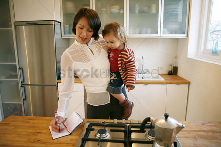 Closeness : Mother carrying daughter while writing