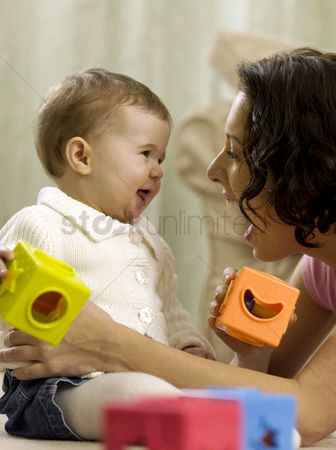 Children playing : Mother playing with baby girl