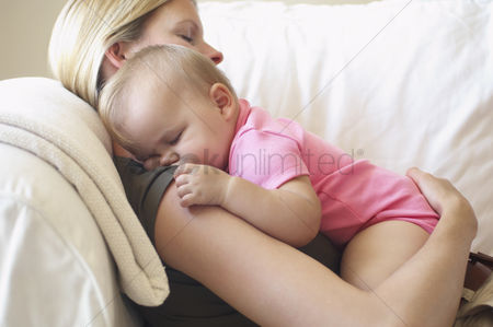 Pink : Mother with baby sleeping on sofa