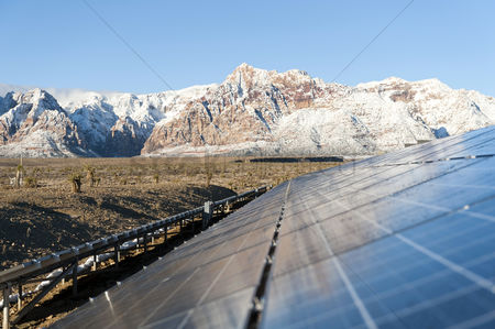 Remote : Mountains behind solar panels