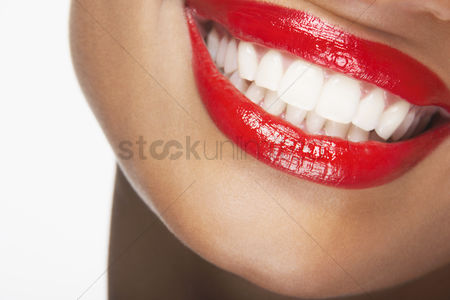 Young woman : Mouth with red lipstick smiling