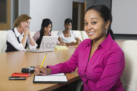Notepad : Multi racial group of businesswomen
