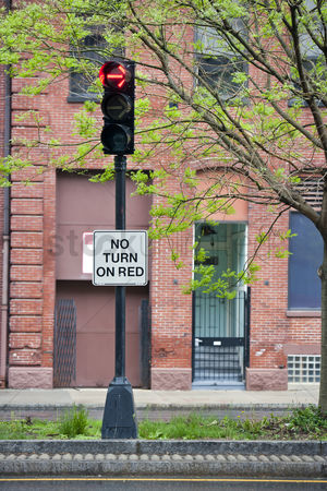 On the road : No turn on red sign on traffic lights
