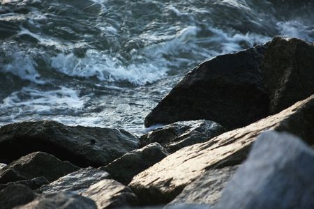 Weathered : Ocean waves crashing on rocks