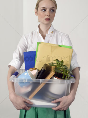 Houseplant : Office worker carrying personal belongings indoors