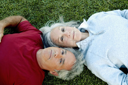 Love : Old couple lying on the grass