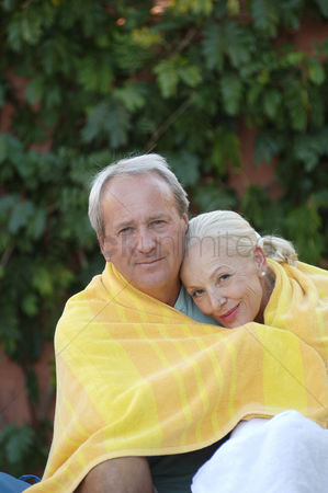 Affectionate : Old couple sharing a towel
