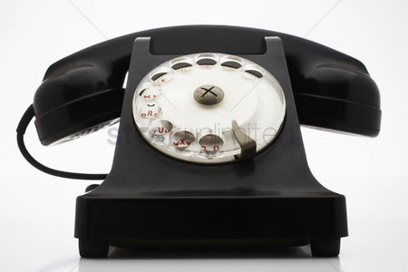 Black background : Old fashioned black telephone in studio