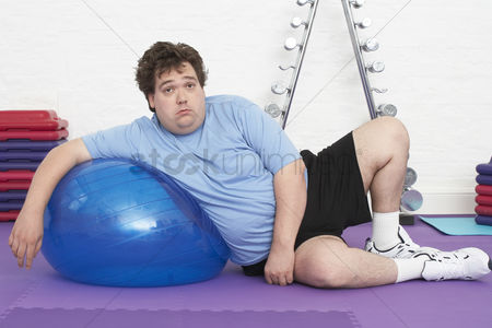 Posed : Overweight man doing gymnastics