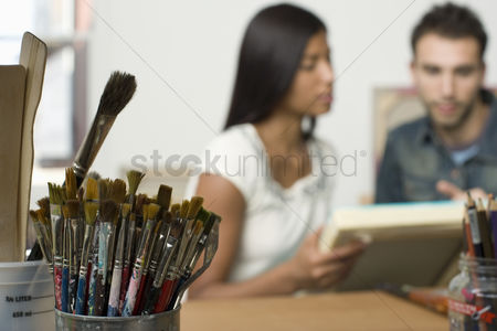 Arts : Paint brushes on artist s work table