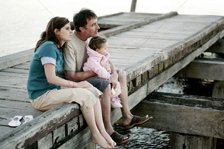 Rest : Parents and daughter sitting at the pier