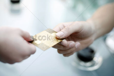 Mature : Paying with a gold credit card