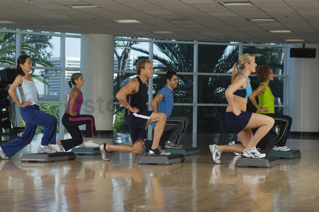 Hispanic : People exercising in step aerobics class