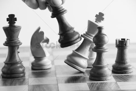 Loss : Person s hand defeating a king in the game of chess