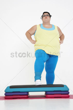 Steps : Plus-size woman on exercise steps