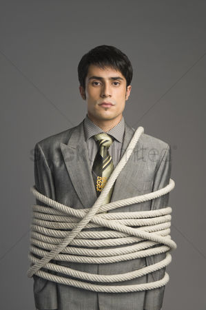 Forbidden : Portrait of a businessman tied up with ropes