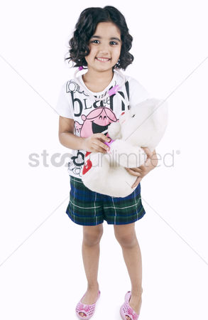 Satisfying : Portrait of a girl examining a teddy bear with a stethoscope