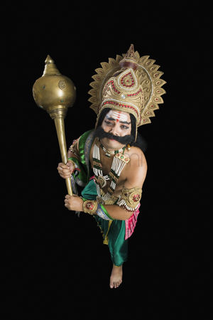 Fight : Portrait of a stage artist dressed-up as ravana and holding a mace