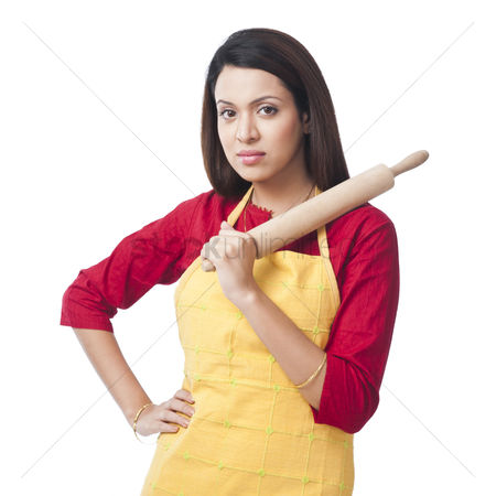 Housewife : Portrait of a woman holding a rolling pin