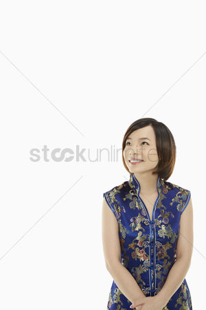 Lunar new year : Portrait of a woman in traditional clothing smiling