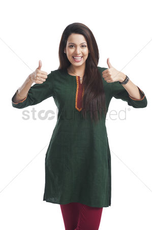 Housewife : Portrait of a woman showing thumbs up sign and smiling
